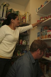People stocking shelves for the food and hygiene pantry