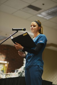 Lindsey works at Mercy Medical Center and came down in the middle of her work day to perform for guests of the Tea in the Hallagan Education Center.